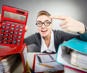 Woman holding calculator Stock Photo 02
