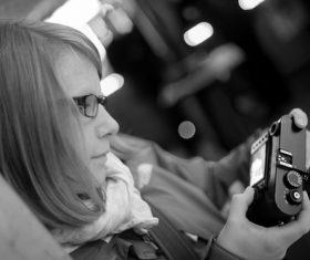 Woman looking at photos taken in the camera Stock Photo