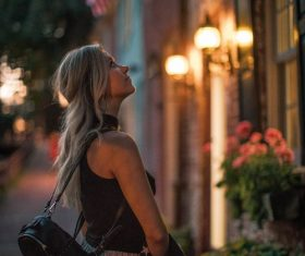 Woman on the street in the evening Stock Photo