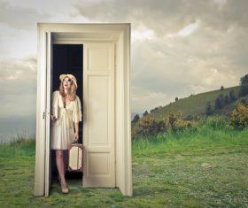 Woman opens the magic door Stock Photo