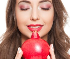 Woman red eye shadow and pomegranate