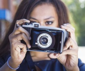 Woman taking photo with camera Stock Photo 01