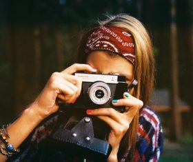 Woman taking photo with camera Stock Photo 02
