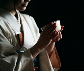 Woman wearing japanese kimono drinking tea Stock Photo