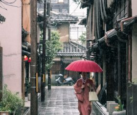 Woman wearing kimono in rainy day holding an umbrella Stock Photo