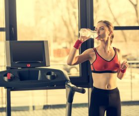 Woman who replenishes water after exercise Stock Photo