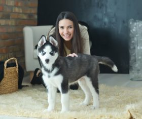 Woman with puppies husky Stock Photo 01