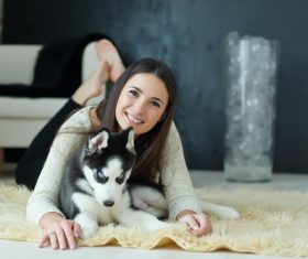 Woman with puppies husky Stock Photo 02