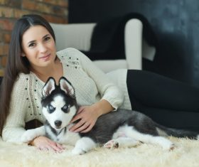Woman with puppies husky Stock Photo 03