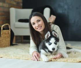 Woman with puppies husky Stock Photo 04