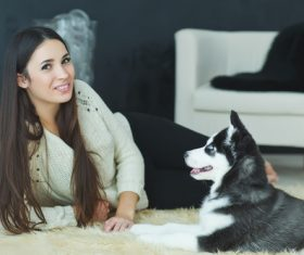 Woman with puppies husky Stock Photo 06