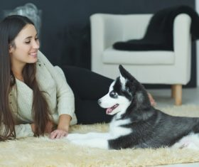 Woman with puppies husky Stock Photo 07
