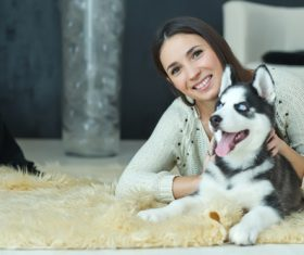 Woman with puppies husky Stock Photo 10