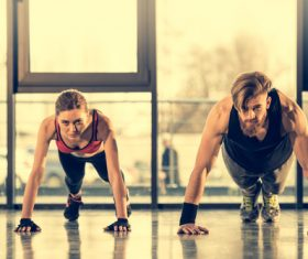 Women push-ups together with coach Stock Photo 01