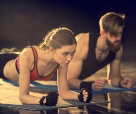 Women push-ups together with coach Stock Photo 02