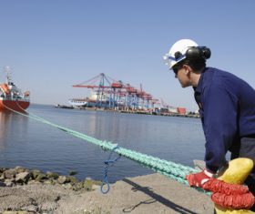 Worker detecting ship rope Stock Photo