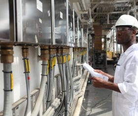Worker with control equipment Stock Photo