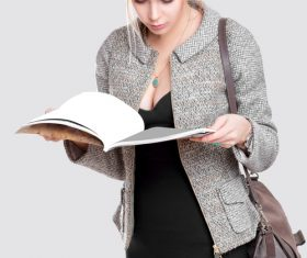 Young beautiful girl looking at documents Stock Photo
