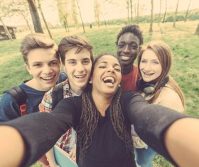 Young friends taking selfies Stock Photo