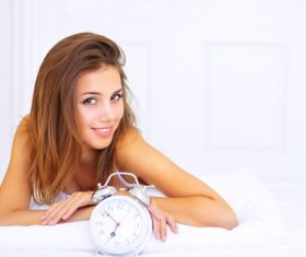 Young girl and alarm clock Stock Photo 01