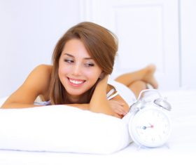 Young girl and alarm clock Stock Photo 02