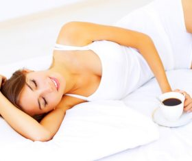 Young girl drinking coffee in bed Stock Photo 01