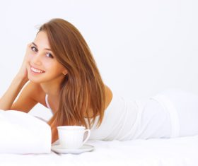 Young girl drinking coffee in bed Stock Photo 03