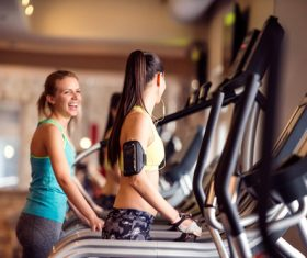 Young woman doing sports on treadmill Stock Photo