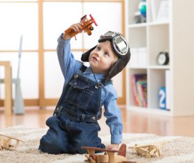 a child playing with a wooden plane Stock Photo 14