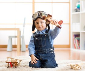 child playing with toy airplane at home Stock Photo 07