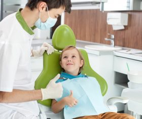 dentist praised the child for being brave Stock Photo