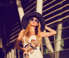 fashion woman is holding pet dog posing Stock Photo 03
