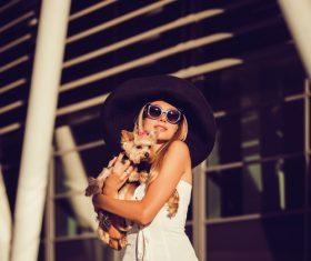 fashion woman is holding pet dog posing Stock Photo 04