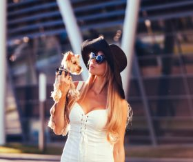 fashion woman is holding pet dog posing Stock Photo 09