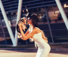 fashion woman is holding pet dog posing Stock Photo 10