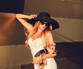 fashion woman is holding pet dog posing Stock Photo 14