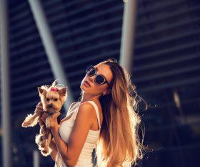 fashion woman is holding pet dog posing Stock Photo 15