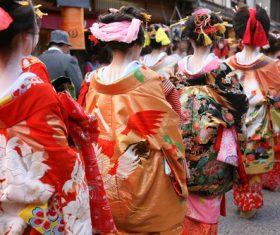 geisha wearing a Japanese kimono cruises the street Stock Photo