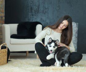 puppies husky and girl play Stock Photo