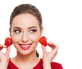 woman who uses strawberries as earrings