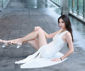 Asian girl sit on the ground pose Stock Photo