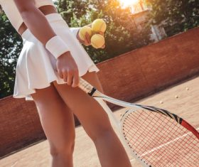 Beautiful female tennis player serving the ball Stock Photo 01