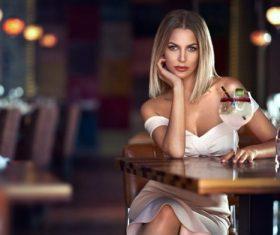 Beautiful woman sitting in the bar Stock Photo