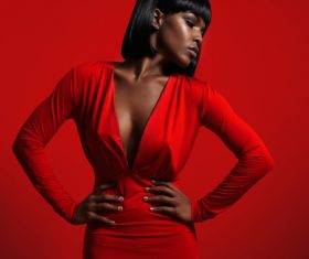Black skinned woman in red evening gown Stock Photo