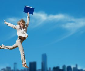 Business lady jumping up Stock Photo