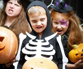 Children dressed as Halloween ghosts Stock Photo 02