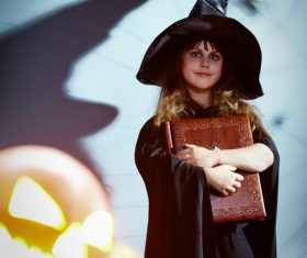 Children dressed as Halloween witches Stock Photo 01