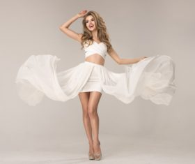 Confident and beautiful woman in white dress Stock Photo 02