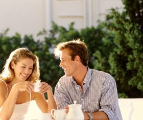Couple having coffee and chatting happily Stock Photo