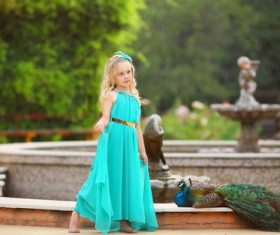 Cute little girl and peacock Stock Photo